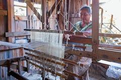 MANDALAY, MYANMAR - NOVEMBER 22,2015: Woman working on a traditi Royalty Free Stock Photography