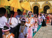 MANDALAY, MYANMAR - DECEMBER 18. 2015: Novitiation novitiate ceremony Shinbyu for young Buddhist boy on sedan chair at Maha royalty free stock photos