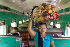 Unidentified burmese woman selling snaсks in the train between Mandalay and Hsipaw in Myanmar stock photos