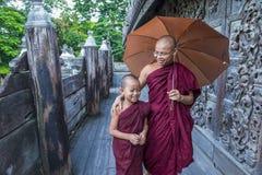 Monks at Shwenandaw Monastery in Mandalay , Myanmar. MANDALAY , MYANMAR - SEP 02 : Monks at Shwenandaw Monastery in Mandalay, Myanmar on September 02 2017 Royalty Free Stock Photography