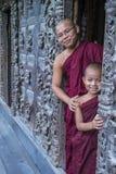 Monks at Shwenandaw Monastery in Mandalay , Myanmar. MANDALAY , MYANMAR - SEP 02 : Monks at Shwenandaw Monastery in Mandalay, Myanmar on September 02 2017 Royalty Free Stock Images