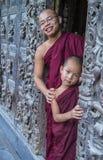 Monks at Shwenandaw Monastery in Mandalay , Myanmar Royalty Free Stock Image