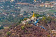 Mandalay. Panorama of the Mandalay city, a sanctuary and a lot of green trees, Myanmar Stock Photos