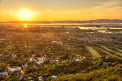 Mandalay seen from hill at sunset, Burma. Mandalay with lake mountains, temples and pagodas seen from mandalay hill at sunset, Burma Royalty Free Stock Photography