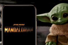 The Mandalorian logo smart phone that is a web television series.  BABY YODA