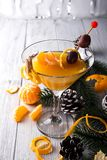Mandarín martini en un vidrio del Año Nuevo Imagen de archivo