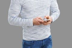 Mandare un sms Immagini Stock