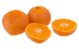 Mandarin against a white background. Fresh whole and a half of an orange mandarin Royalty Free Stock Image