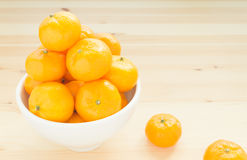 Mandarin or China Orange in White Bowl with two orange on wood t Stock Images