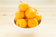 Mandarin or China Orange in White Bowl on Wood Table Center Fram Royalty Free Stock Photography
