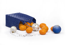 Mandarin Christmas. Christmas-tree lot Mandarin and balls fall from package Stock Photography