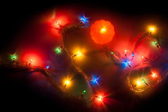 Mandarin and Christmas light Stock Images