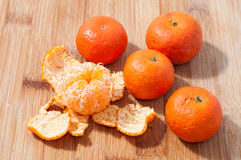 MANDARIN CITRUS. Some mandarin citrus on chopping board Stock Photo