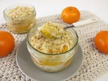 Mandarin crumb cake baked in a jar Royalty Free Stock Image