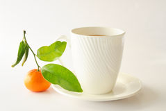 Mandarin with cup of tea Stock Images