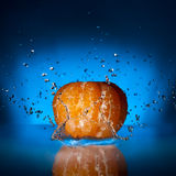 Mandarin falling into water Royalty Free Stock Image