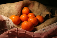 Mandarin fruit. Fresh orange Mandarin fruits on jute royalty free stock photos