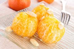 Mandarin fruit with honey sauce and almond Stock Images