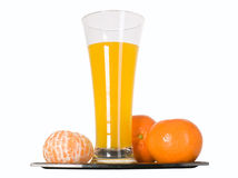 Mandarin fruit and orange juice in glass Royalty Free Stock Photography