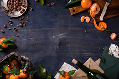 Mandarin fruits with hazelnuts and wine on wooden background. Healthy organic food frame. Top view, copy space, mock-up. Royalty Free Stock Image