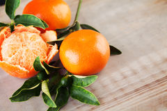 Mandarin Fruits on Wooden Background Royalty Free Stock Photos