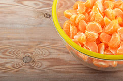 Mandarin in glass bowl. On wooden background royalty free stock photos