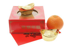 Mandarin, Gold Ingots and Chinese New Year Cake Royalty Free Stock Image