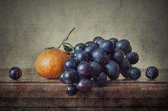 Mandarin with grapes Stock Images