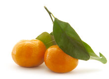 Mandarin with green leaf Royalty Free Stock Photo