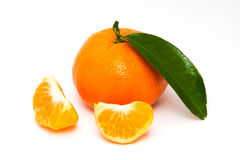 Mandarin with green leaf Royalty Free Stock Images