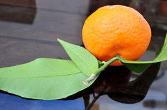 Mandarin with green leaves Royalty Free Stock Photos