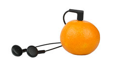 Mandarin and headphones Royalty Free Stock Image