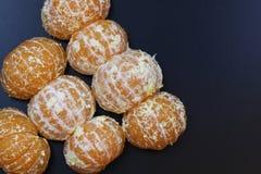 Mandarin het fruit isoleert zwarte Stock Afbeelding