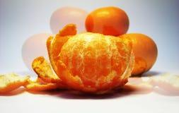 Mandarin illusion. Reflection on the grey background stock image