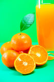 Mandarin and juice Stock Images