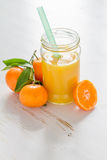 Mandarin juice in glass jar Royalty Free Stock Images