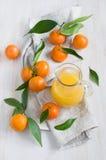 Mandarin and juice Stock Photo