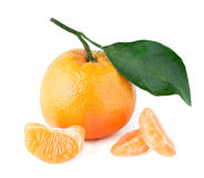 mandarin with a leaf and segments Stock Photos