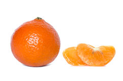 Mandarin with leaves close-up on a white background.  Royalty Free Stock Images