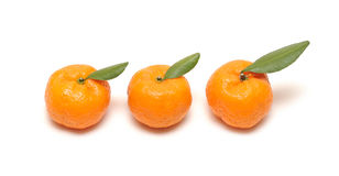 Mandarin with leaves on white Royalty Free Stock Photography
