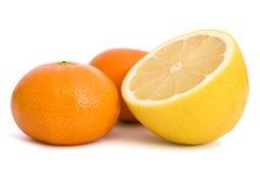 Mandarin and lemon. Fresh mandarin and lemon on isolated background Royalty Free Stock Photos
