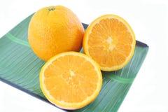 Mandarin lemon on tray. Mandarin lemon on green tray Stock Photo