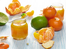 Mandarin and lime jam. Mandarin and lime marmalade in a jars with fresh fruits Royalty Free Stock Images
