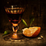 Mandarin and liquor Stock Image