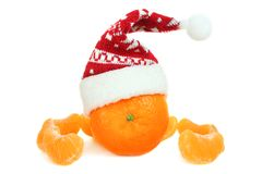 Mandarin in a New Year hat. Isolated on white background Royalty Free Stock Image