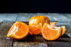 Mandarin on an old wooden table in an Royalty Free Stock Photos
