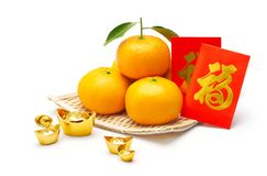 Mandarin orange, chinese gold and red packet Stock Photography