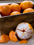 Mandarin Orange or Clementines. A wooden box full of fresh citrus mandarin oranges or clementines stock photography