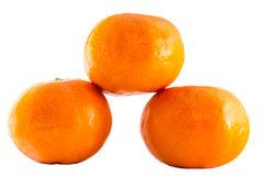 Mandarin and orange, close up with selective focus. Royalty Free Stock Photos