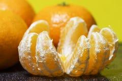 Mandarin orange fruit, peeled on a black background Royalty Free Stock Photos
